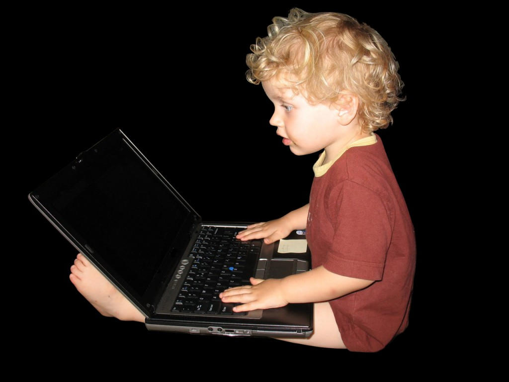 Kid typing computer